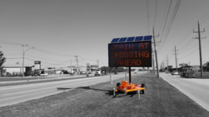 Dynamic messaging signs used to reroute drivers around blocked crossings.